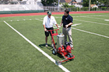 Pioneer Athletics Sales Representative demonstrating a Brite Striper 1600